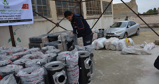 Tel Abyad ve Resulayn'da çocuklar üşümeyecek